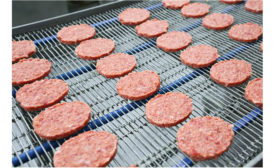 default frozen burger patties on conveyor